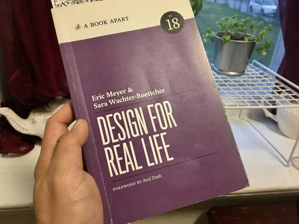 "A picture of the book, ""Design for Real Life"", in my hand."
